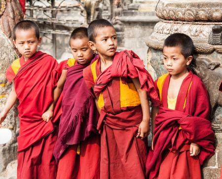 nepali: NEPAL, Swayambhunath - 4th May 2014 - Young Buddhist children in Swayambhunath, Nepal.