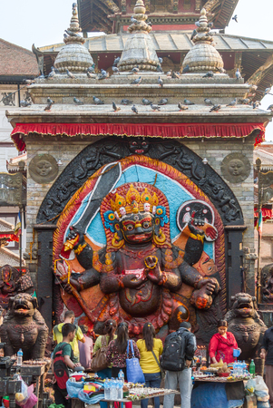 KATHMANDU, NEPAL, April 29th 2014 - Hindus  in Durbar Square worshipping the god Kala Bhairava, a fierce form of Shiva.