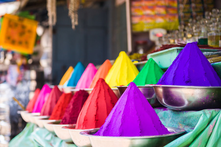 Bowls of vibrant colored dyes in India - holi colors. Stock Photo