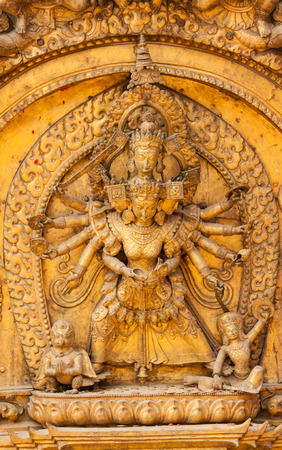 nepali: A gilded statue on the famous Golden Gate of the Nepalese Goddess Teleji Bhavani in Bhaktapur, Nepal Stock Photo