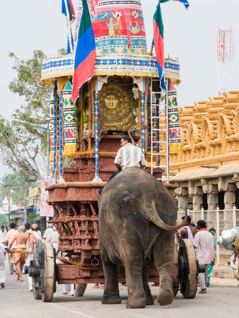 NANJANGUD, INDIA - FEB 13th 2008 - An elephant pushes a chariot during a ratha festival at the temple of Srikanthesvara at Nanjangud in South India.