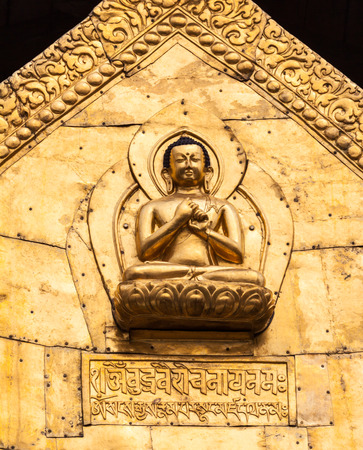 A gilded Buddha on a temple roof