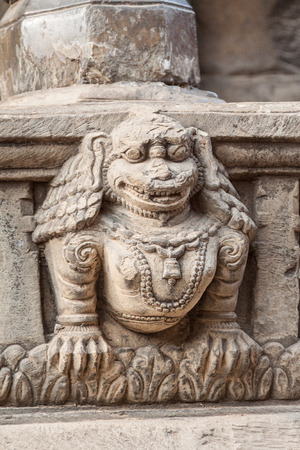 nepali: A stone lion carved into a temple step in Bhaktapur, Nepal.