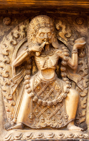 A gilded relief of the Hindu Goddess Kali on the Golden Gate in Bhaktapur, Nepal.