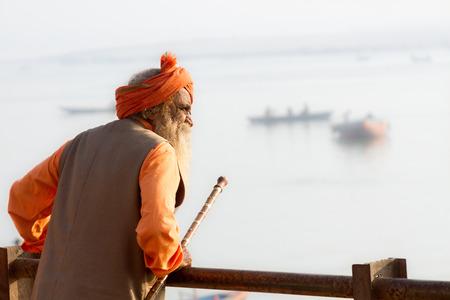 sadhu: VARANASI, INDIA - FEB 18 - An old Hindu sadhu look out at the River Ganges in Varanasi on February 18th 2013