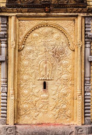 filagree: A gold gilded temple door in Swayambhunath, Nepal. Stock Photo
