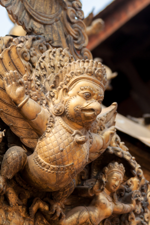 garuda: A gilded statue of Garuda, the half-man, half bird carrier of the Hindu god Vishnu.