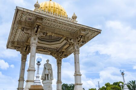 The statue of Chamarajendra Wodeyar in front of the Mysore Palace in India.