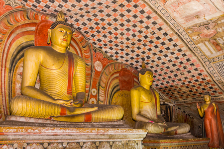 tantric: Statues of Buddha sitting in the ancient Dambulla Cave Temple in Sri Lanka.