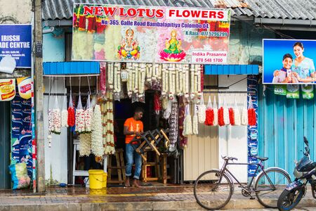 colombo: Colombo, Sri Lanka - Circa November 2016: A traditional flower and garland shop in Colombo, Sri Lanka. Editorial