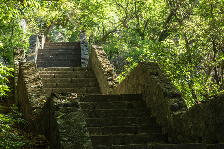 ancients: Ancients granite stairs on a jungle hillside in asia.