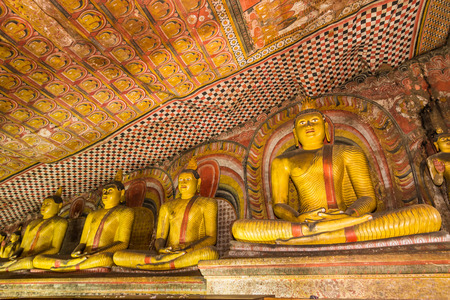 buddha sri lanka: Statues of Buddha in the ancient Dambulla Cave Temple in Sri Lanka.