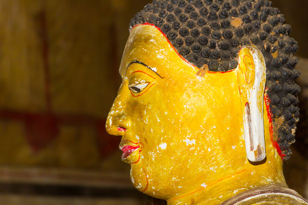 buddha sri lanka: A closeup on the face of a statue of Buddha in the ancient Dambulla Cave Temple in Sri Lanka.