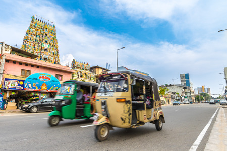 Colombo, Sri Lanka - Circa November 2016: Traffic in front of a Hindu Temple on Galle Road, Colombo, Sri Lanka