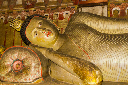 tantric: A statue of reclining Buddha in the ancient Buddhist cave temple at Dambulla, Sri Lanka.