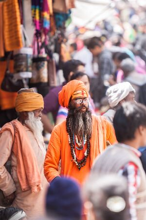 BADRINATH  INDIA, JUNE 5th - A sadhu amongst pilgrims on the streets near the temple of Badarinath in North India on June 5th 2013 Editorial