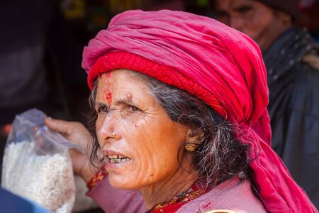BADRINATH - INDIA, JUNE 5th - An old female pilgrim at the temple of Badarinath in North India on June 5th 2013 Editorial