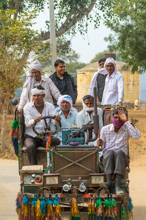abhaneri: Abhaneri, India, 21st January 2017 - Villagers driving a tractor in Abhaneri, Rajasthan, North India.