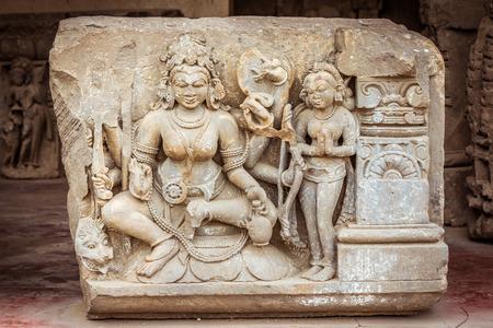 abhaneri: A broken sculpture of Goddess Durga at the Chand Baori stepwell in Abhaneri, Rajasthan, North India.