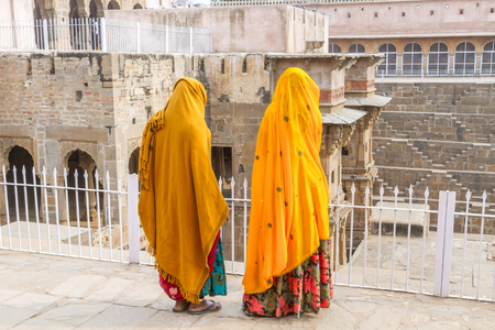 chand baori: Abhaneri, India, 21st January 2017 - Two women stand at the Chand Baori stepwell in Abhaneri, Rajasthan, India.