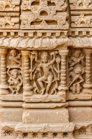 chand baori: A worn carving of the Hindu god Shiva at Chand Baori Stepwell at Abhaneri, Rajasthan, India.