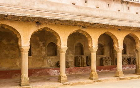 abhaneri: A corridor and pillars at Chand Baori stepwell in Abhaneri, Rajasthan, India. Stock Photo