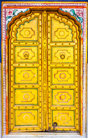 A gold doors of a Hindu temple on the way to Jaipur in Rajasthan, India.