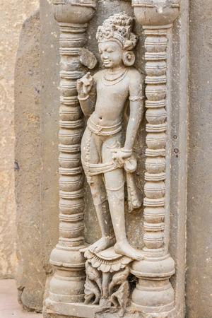 baori: A carving of an Apsara (heavenly nymph) at the Chand Baori stepwell in Abhaneri, Rajasthan, India.
