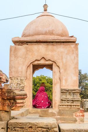 Abhaneri, India, 21st January 2017 -A Hindu Woman worshipping a Shiva Lingam at the Harshat Mata Temple in Abhaneri, Rajasthan, India. Editorial