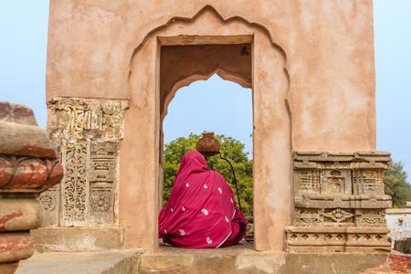 abhaneri: Abhaneri, India, 21st January 2017 -A Hindu Woman worshipping a Shiva Lingam at the Harshat Mata Temple in Abhaneri, Rajasthan, India. Editorial