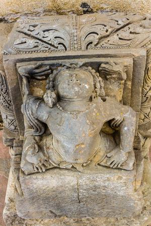 abhaneri: A Carving of a yogi doing an asana at Chand Baori Stepwell in Abhaneri, Rajasthan, India. Stock Photo