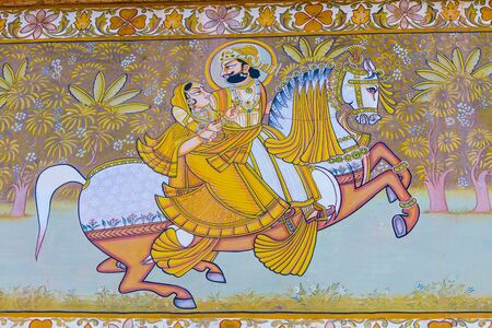 A fresco outside the Mehrangarh Fort depicting a king and queen on a horse. Editorial