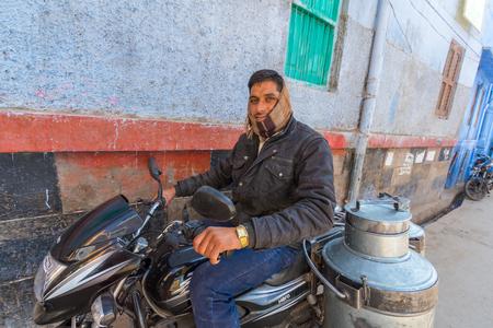 milkman: Jodhpur, India,17th January 2017 - A milk man on a motobike in Jodhpur, India. Editorial