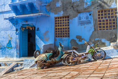 Two old bikes outside a house in the Blue City of Jodhpur, India. Stock Photo