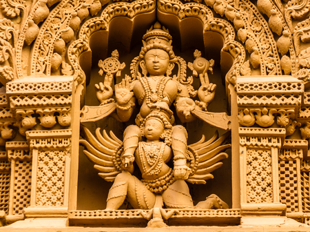 A sculpture of the Hindu God Vishnu on his carrier Garuda at the temple of Srikantheswara in Nanjangud, South India.