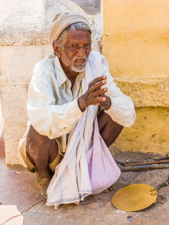 NANJANGUD, INDIA - FEB 1st 2008 - A old beggar outside the temple of Nanjangud, South India.