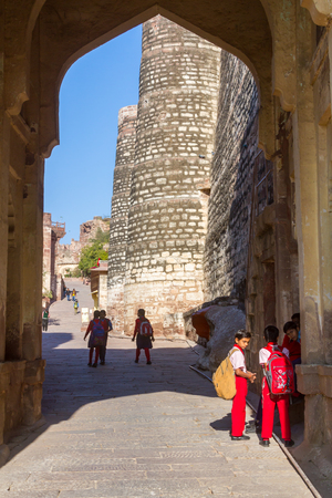 Jodhpur, India, 16th January 2017 - Children walking thru a gateway at the Mehrangarh Fort in Jodhpur, India.