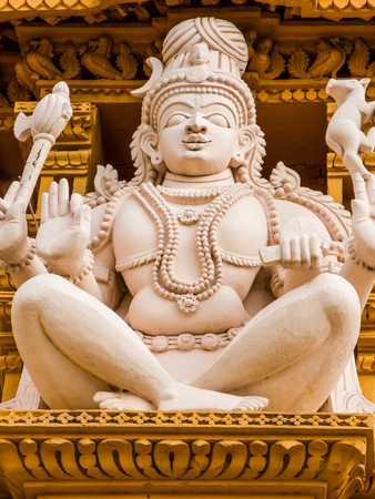 A detail of Lord Shiva on the gopuram tower at the famous temple of Srikanthesvara at Nanjangud, South India.