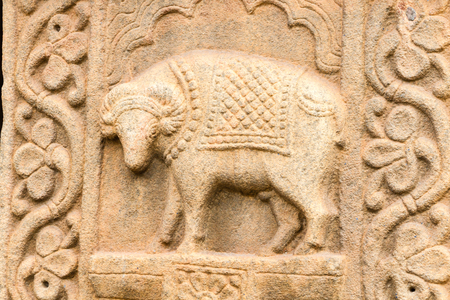 A carving on a pillar of a cow at the Srikantheswara Temple in Nanjangud, South India. Stock Photo