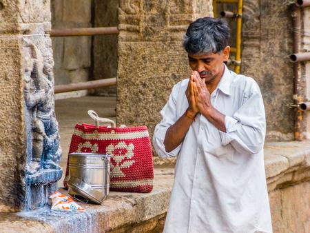 NANJANGUD, INDIA - FEB 13th 2008 - A Hindu man praying at the temple of Nanjangud, South India.