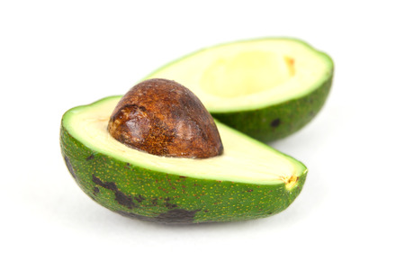 Green Avocado with a pit Imagens