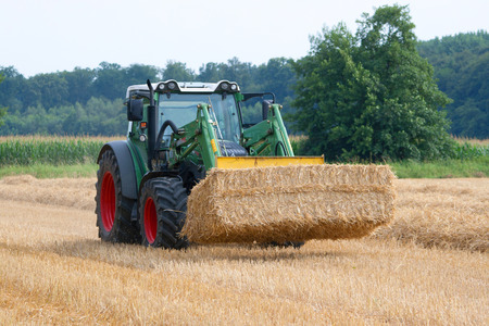 Carry away straw bales Stock Photo