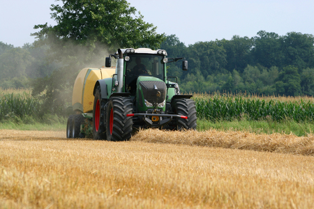 baler: Tractor with straw baler Stock Photo