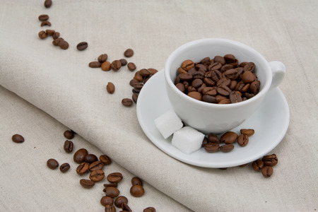cafe au lait: Coffee cup full of beans with sugar