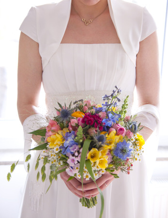 in particular: Bride with bridal bouquet in the hand