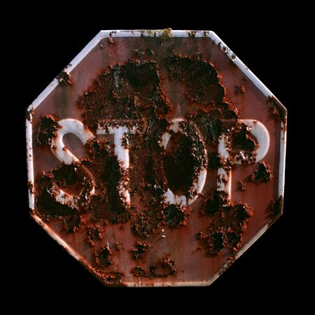 advisement: A rusty STOP signal isolated on black Stock Photo
