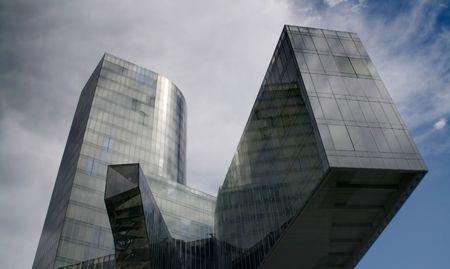 architectonics: Business building, blue glass, clouded sky background