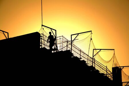 worker and sunset. under construction, working protection. Stock Photo - 3211322