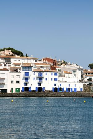 typical mediterranean village, white houses at the coast