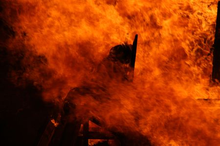 assasin: celebration of st joan, a burning man on flames